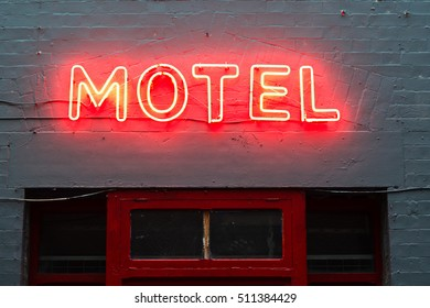 Motel neon sign lit up at night