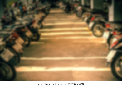 A lot of motercycles in the parking lot
