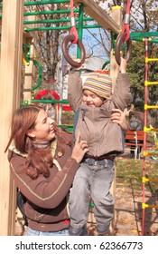 Mother and 2 years old son on the playground.