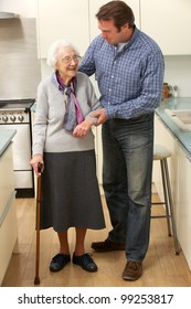 Mother and adult son in kitchen