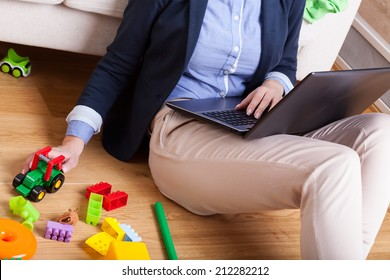 Mother after long day working on computer