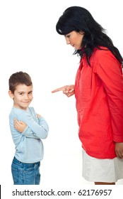 Mother arguing her child .The boy smile and  standing with hands crossed and does not pay attention to her