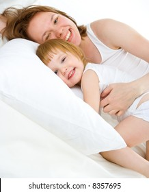 mother an baby in bed have fun