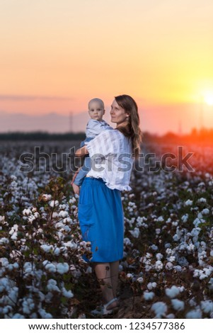 mother-baby-cotton-field-sunset-450w-123