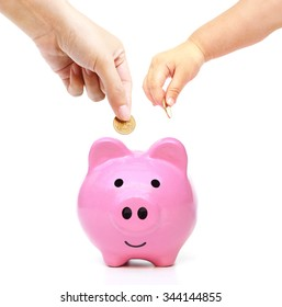 mother, and baby in the family do saving money in pink piggy bank