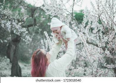 Mother and baby girl blossom tree