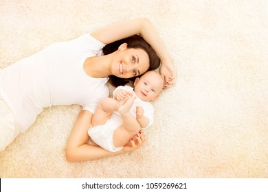 Mother and Baby, Happy Family Portrait, Mom with Kid Lying on Carpet, Woman and Child in White Clothing