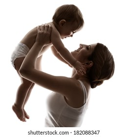 mother and baby, happy family raising up smiling child, isolated silhouette on white background.