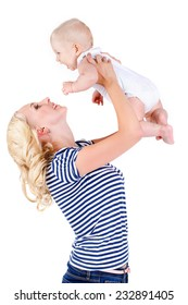 Mother with baby isolated on white. Happy mother and daughter playing on the white background. Happy family. A young mother and baby rests
