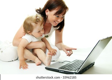 Mother and baby with laptop isolated on white