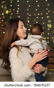 Mother and baby on Christmas holiday
