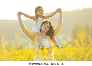 Mother with baby on nature