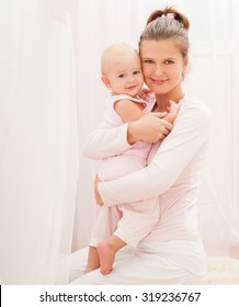 Mother and baby playing and smiling. Happy family.Home interior.