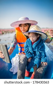Mother and baby are playing tablets and a boat ride at Lake Lotus Red Sea