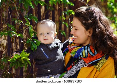 mother and baby son outdoors, focus on mother's face