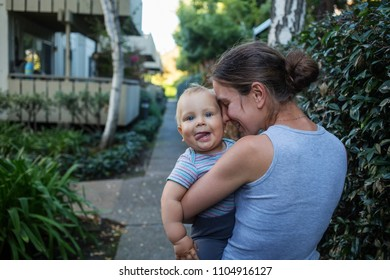 A mother with baby son in park
