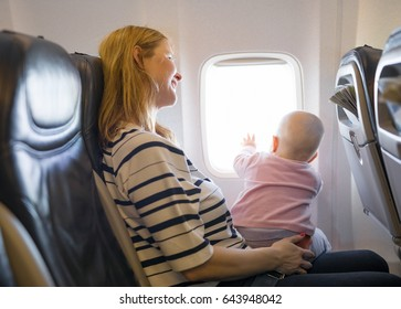 Mother and baby traveling on plane