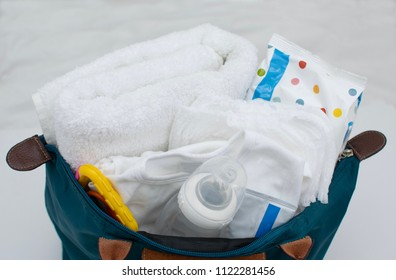 Mother bag with many baby stuff inside