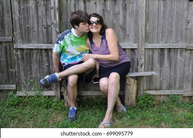 Mother being Kissed by Son with Autism Disability