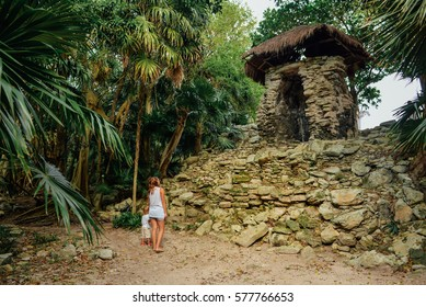 Mother and a boy near Xaman-Ha ruins, Playa del Carmen, Mexico