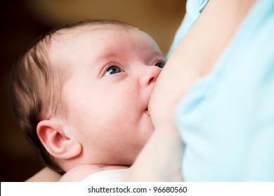 Mother breast feeding newborn baby
