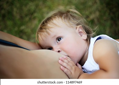 mother breast-fed her infant and the newborn watch the mother