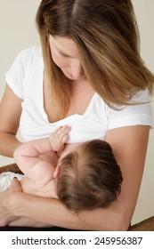 Mother breastfeeding, nursing her newborn baby