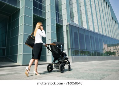 Mother in business world with baby carriage