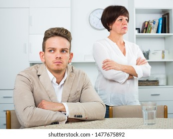 Mother calms the son and persuades him not to be upset