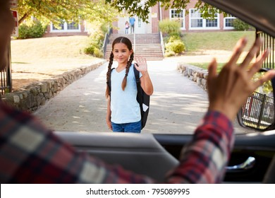 Mother In Car Dropping Off Daughter In Front Of School Gates