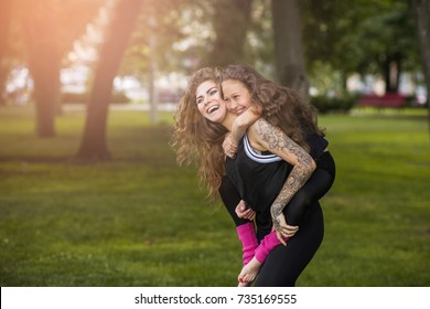 Mother care motherhood friendship concept. Motherly love. Happy lifestyle together. Beautiful smiling family in focus on foreground. Forever young.