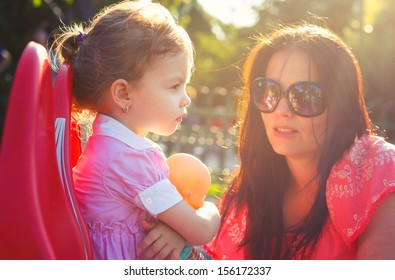 Mother chatting with her daughter