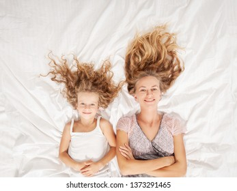 Mother with child in bedroom