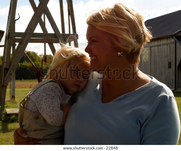 Mother and child by windmill