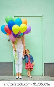 mother and child with colorful balloons mother and child with colorful balloons on green background