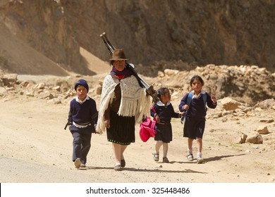 Mother With Child Coming Back From School Are Forced To Walk Miles Due To The Lack Of Public Transportation In The Area