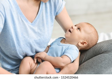 Mother and child connection. Cute newborn baby looking at his mom with adoration, closeup