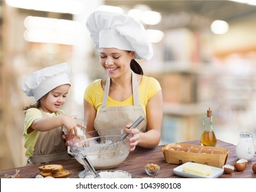 Mother and child cooking