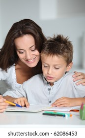 Mother and child doing homework