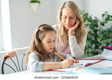 A Mother and Child doing homework at home