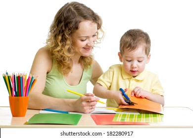 Mother and child draw and cut together