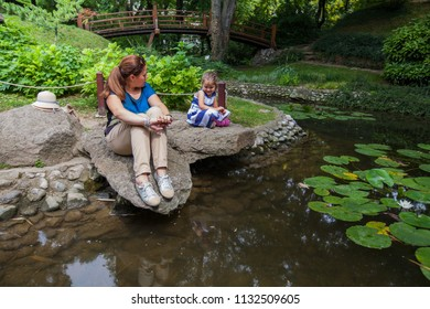 Mother and child enjoy nature, family spring day outdoor