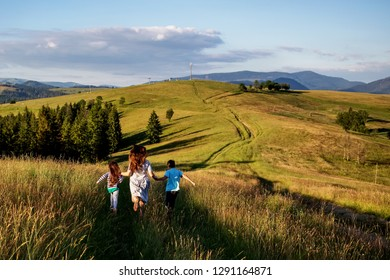 mother and child are having fun in the mountains During summer day