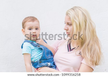 Mother Child Her Arms Against Wall Stock Photo (Edit Now) 1099316258