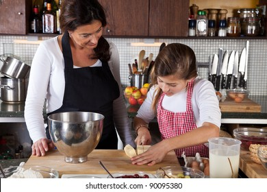 Mother and child in the kitchen baking together