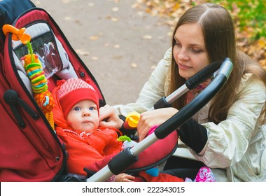 mother with child on walk stroller