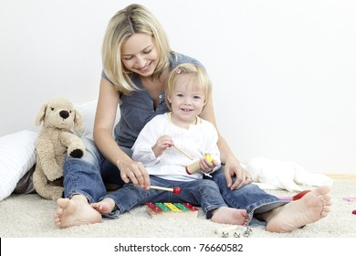 mother and child play instruments