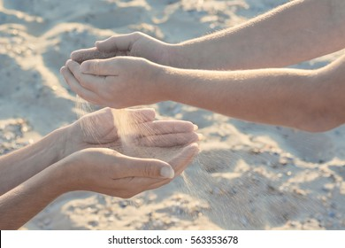 Mother and child play with sand. Boy throws sand to the mothers arms. Active parents and people outdoor activity on summer vacations with children.