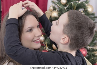 Mother and child playing on Christmas Eve