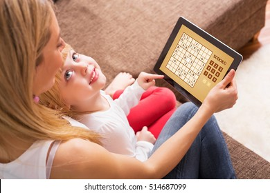 Mother and child playing Sudoku together